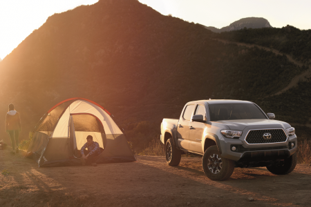 Toyota Tacoma next to a tent