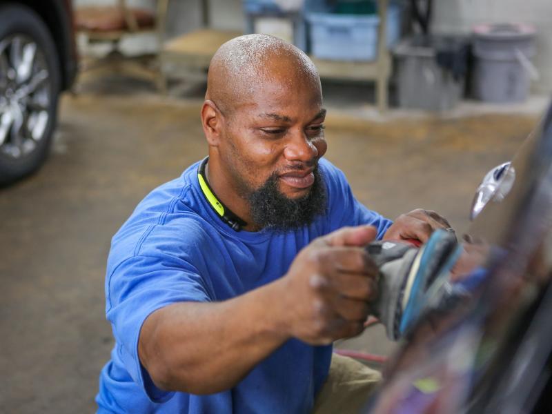 Man detailing car