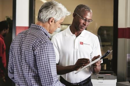 Toyota car salesman helping customer